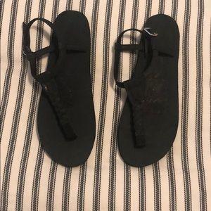 Never worn black Rainbow sandals size large